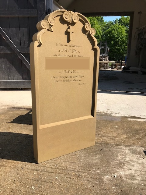 Beautifully crafted brown gravestone