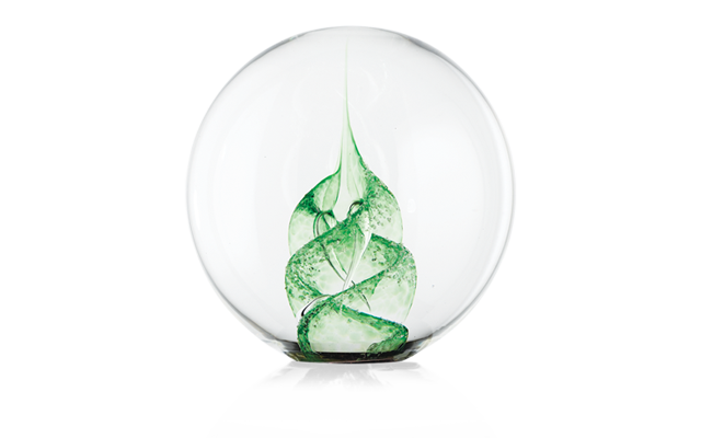 Clear paperweight with a beautiful green spiral through the middle